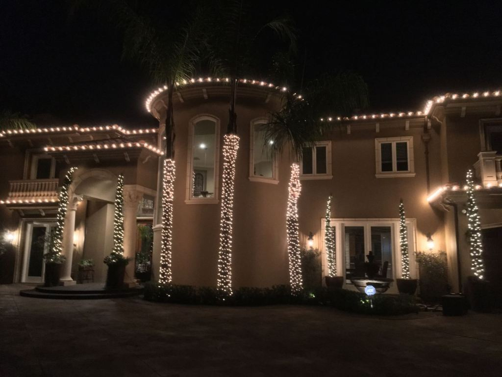 Christmas lights installed on a home in Newport Beach, CA